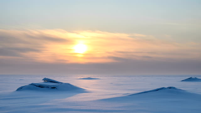 Sunset in the frozen sea. video