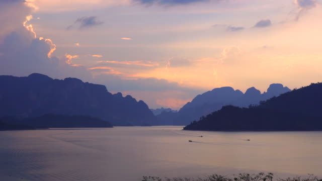 sunset landscapes over the lake on mountains background summer holiday