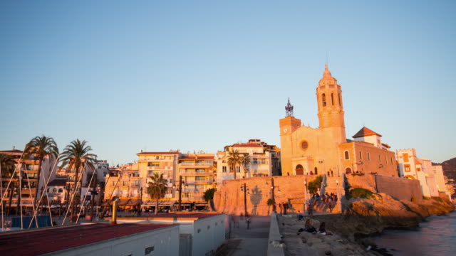 sunset light church of sant bartomeu and santa tecla 4k time lapse sitges spain video