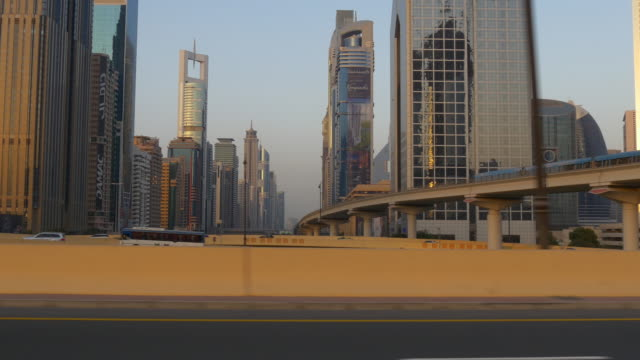 sunset light dubai city downtown driving car pov side panorama 4k united arab emirates