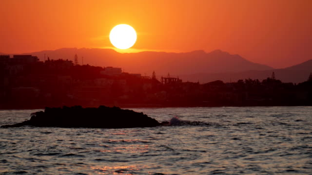 Sunset mountain town and coast. Real time 4k Real time shot of Sunset behind the Akrotiri Peninsula in the Island of Crete. greek islands stock videos & royalty-free footage