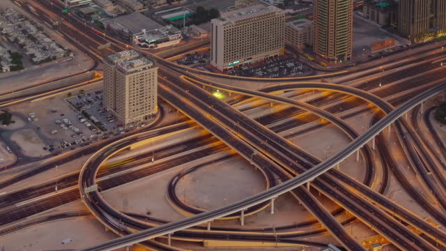 sunset night illumination traffic road junction roof top view 4k time lapse united arab emirates video