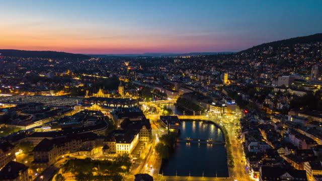 sunset night illumination zurich center cityscape riverside aerial panorama 4k time lapse switzerland video