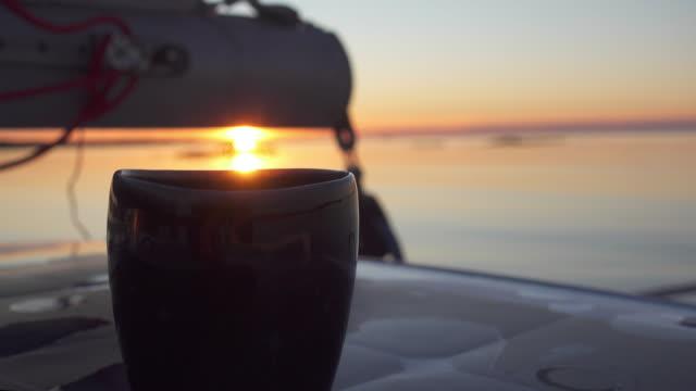 solnedgång på en kopp - rådig bildbanksvideor och videomaterial från bakom kulisserna