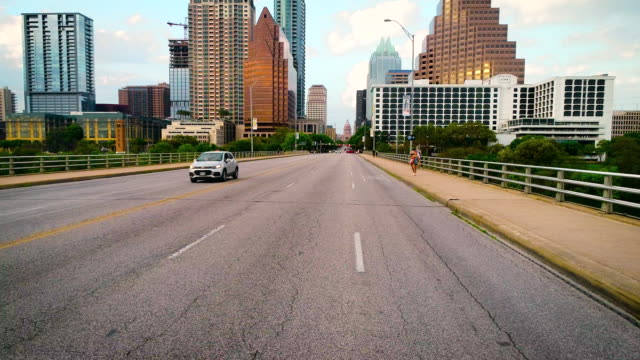 Sunset on Congress Avenue Bridge the Landmark View down to The Austin Texas Capital State Building On the street level during empty roads during Covid-19 or Coronavirus Lockdown - Sunset on Congress Avenue Bridge the Landmark View down to The Austin Texas Capital State Building avenue stock videos & royalty-free footage