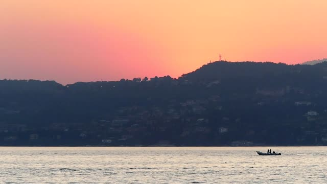 Sunset on lake Garda seen from the port of Sirmione