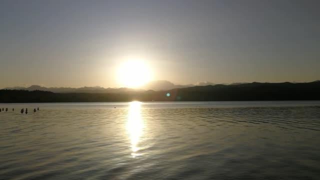 vídeos de stock e filmes b-roll de sunset on lake maggiore near arona and angera - lago maggiore