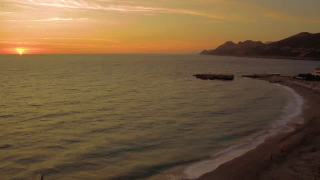 Sunset on the beach by the sea of waves, Montenegro, Time Lapse video