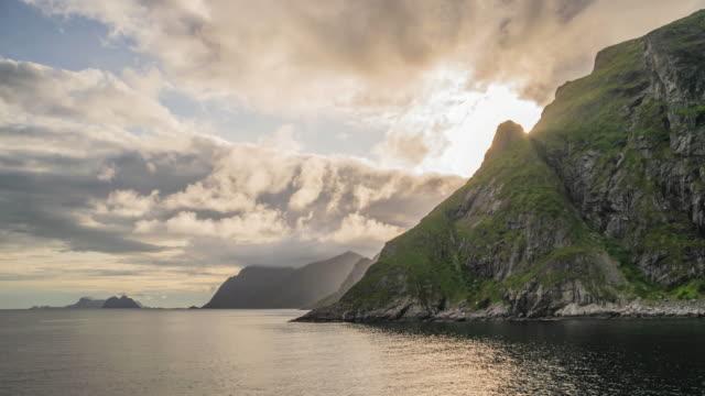 sunset on the lofoten islands and the sea. - fiordo video stock e b–roll