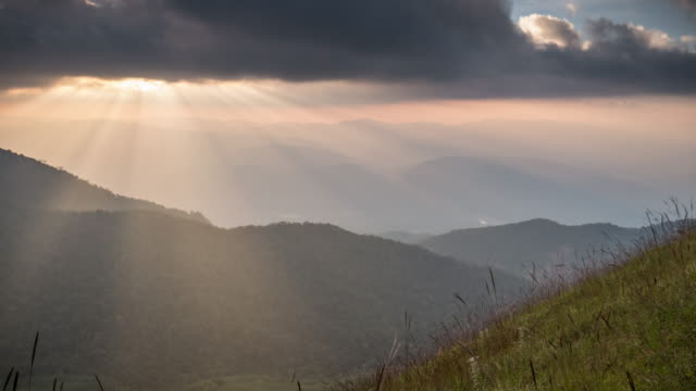 sunset on the mountain with sunlight ray , time lapse movement - highlands scozzesi video stock e b–roll