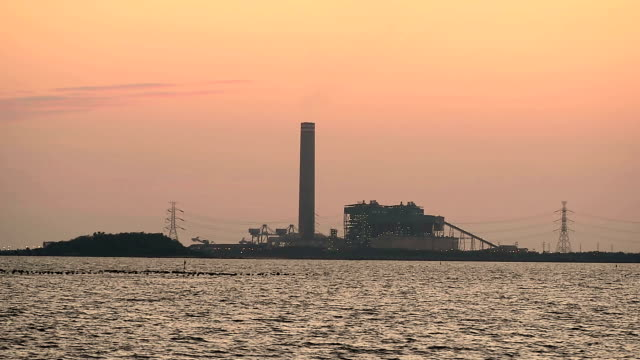 Sunset on the power plants at rayong province Thailand video