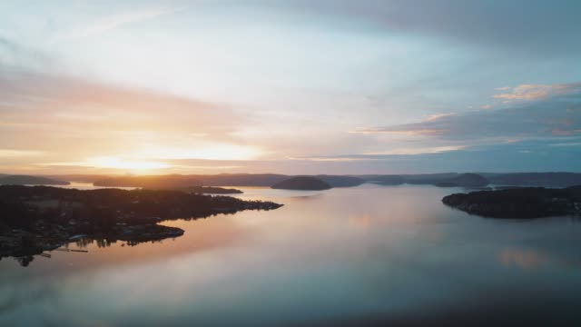 Sunset over a beautiful coastal landscape in Sweden Aerial footage of the sun setting over a beautiful coastal landscape in Sweden on an autumn afternoon. coastal feature stock videos & royalty-free footage