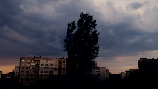 Sunset over city, home buildings communist architecture, cloudy sky,  time lapse