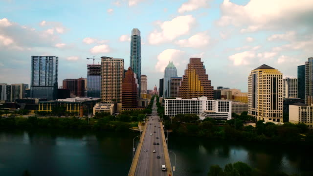 Sunset over Congress Bridge Sunset over Congress Bridge aerial drone views above Lady Bird Lake in Austin Texas USA during Golden Hour sunset avenue stock videos & royalty-free footage