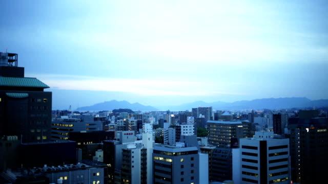 sunset over hiroshima buildings - hiroshima stok videoları ve detay görüntü çekimi