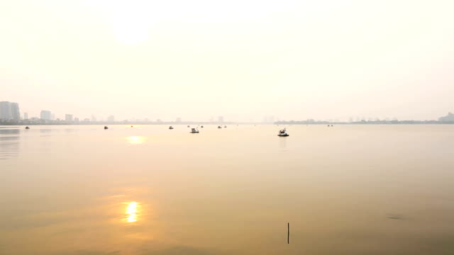 Sunset over ho truc bach lake Hanoi Vietnam in HD video video