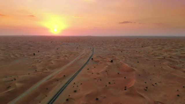 Sunset over Middle Eastern desert Aerial view of sand dunes in the desert in Abu Dhabi, UAE at sunset horizon over land stock videos & royalty-free footage