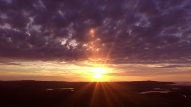 Sunset over mountain hills, aerial panoramic view. video