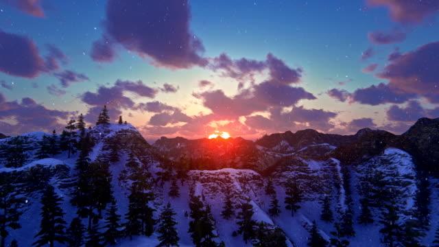 sonnenuntergang über bergrücken - schneeflocke sonnenaufgang stock-videos und b-roll-filmmaterial