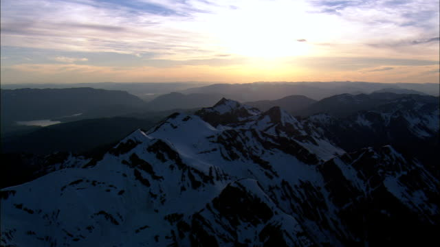 Sunset over mountains - Aerial View - Montana, Flathead County, United States video