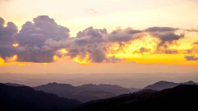 Sunset over mountains sunset over mountains. horizon over land stock videos & royalty-free footage
