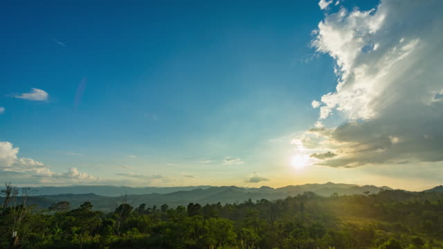 Sunset over Multi-Layer Silhouette Mountains, Time Lapse Video Sunset over Multi-Layer Silhouette Mountains, Time Lapse Video. Crane down shot. sugar cane stock videos & royalty-free footage