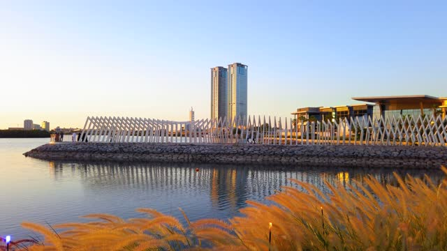 Sunset over Ras Al Khaimah creek and cityscape on a calm evening, the downtown of a northern emirate of the UAE