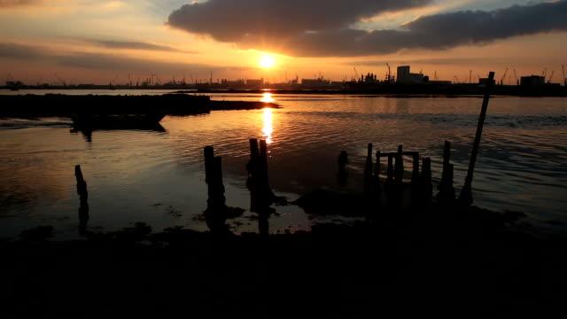 sunset over ravenna port - ravenna stok videoları ve detay görüntü çekimi