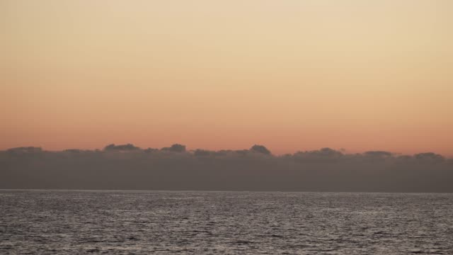 sunset over sea surface time lapse - пелопоннес стоковые видео и кадры b-roll