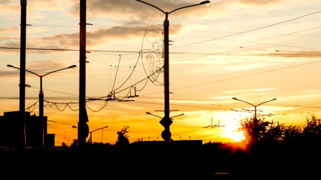 stockvideo's en b-roll-footage met zonsondergang over de stad time-lapse - bankdruktoestel