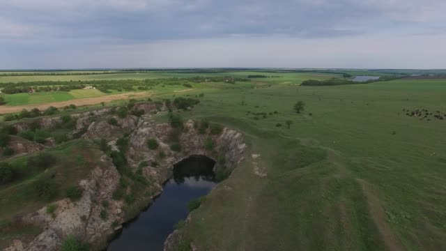 Sunset over the lake with rocky shores in the prairie video
