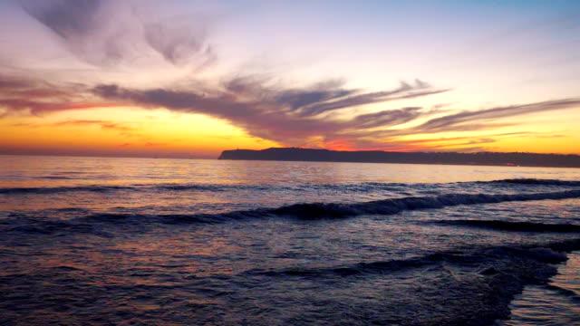 sunset over the ocean in slow motion 180fps - oceano atlantico video stock e b–roll