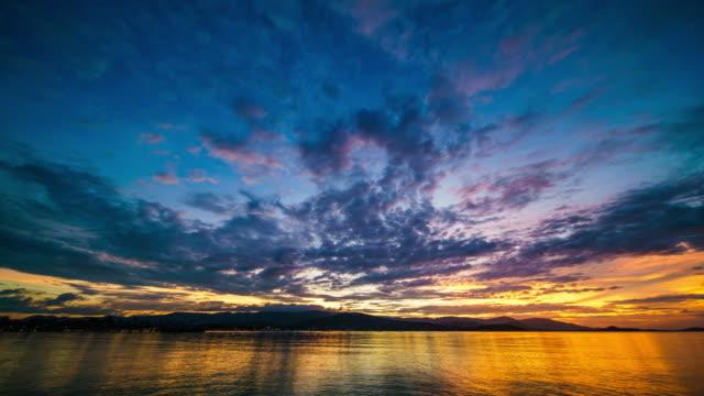 海 4 K の時間の経過に沈む夕日 ビデオ