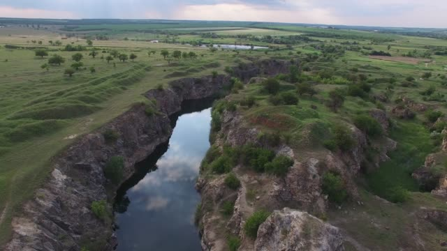 Sunset over the small canyon with rocky shores video