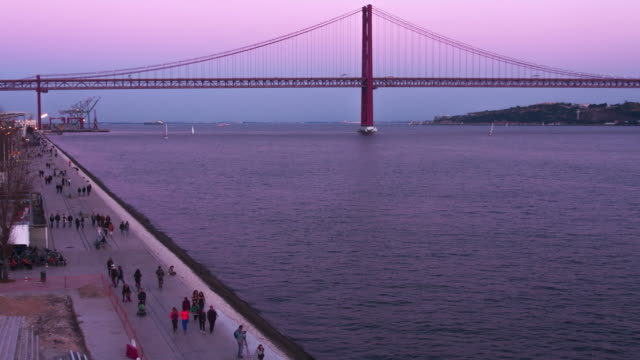 Sunset over the Tagus River Timelapse viddeo footage of the Tagus River during Sunset in Lisbon, Portugal. ponte 25 de abril stock videos & royalty-free footage