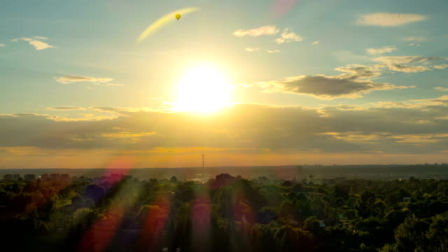 Sunset over Vilnius with balloons and TV Tower, Lithunia, time-lapse video