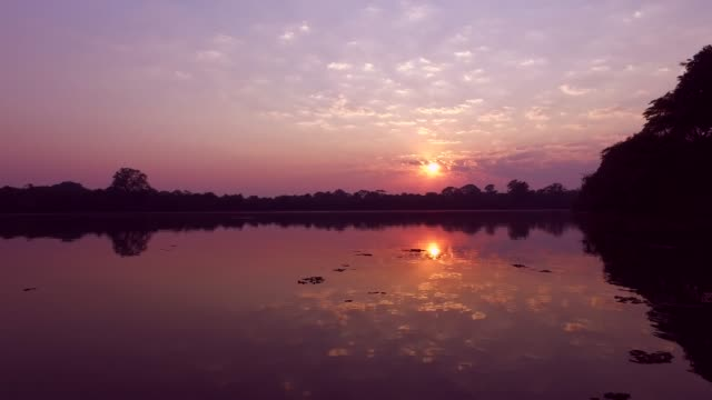 Sunset over water Sunset over water hungary stock videos & royalty-free footage