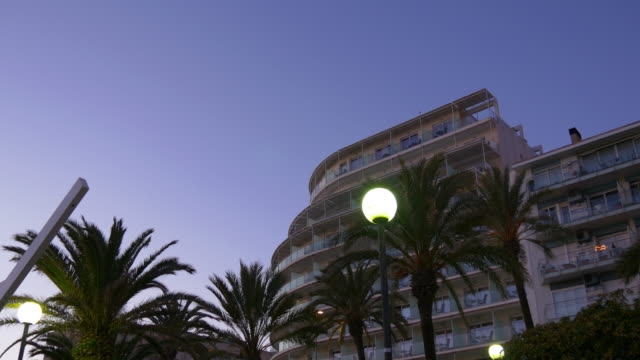 sunset palm view on hotel 4k spain video