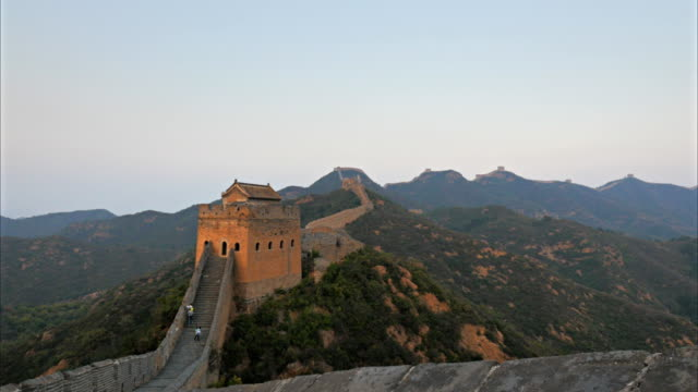 sunset panning shot of the great wall of china - ming video stock e b–roll