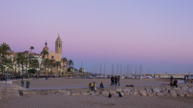 sunset panorama beach view on famous church 4k spain video