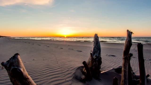 Sunset Sea Jib Arm Timelapse 4k Sunset motionlapse shot with a jib arm. baltic countries stock videos & royalty-free footage