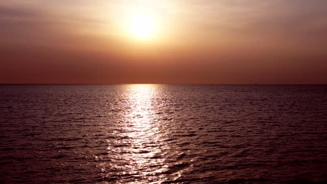 Sunset sea landscape with clouds and waves video