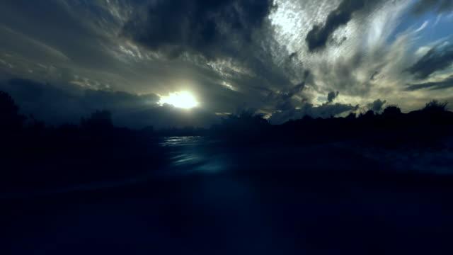 Sunset seen from water level bleu light rays underwater. video