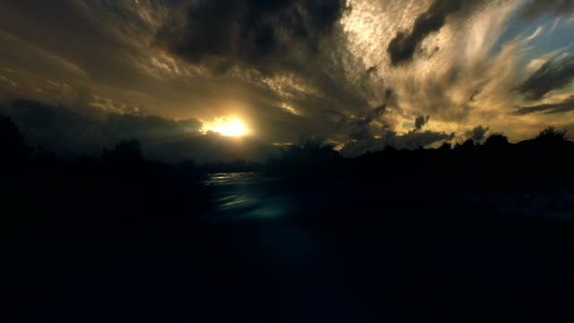 Sunset seen from water level bleu-green light rays underwater. video