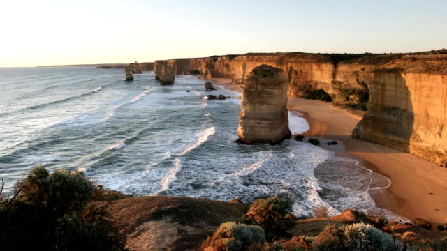 sunset shot looking west at the twelve apostles on the great ocean road - melbourne stock videos & royalty-free footage