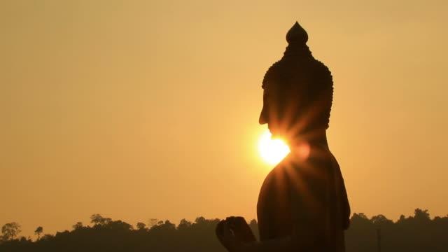 Sunset side big buddha statue silhouette. video