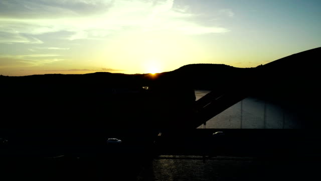 Sunset Silhouette side pan next to pennybacker bridge