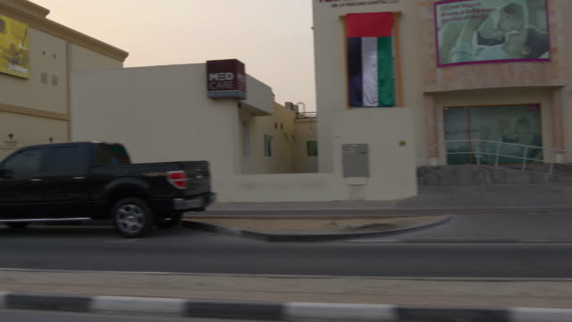 sunset sky dubai city road trip side window  4k united arab emirates video