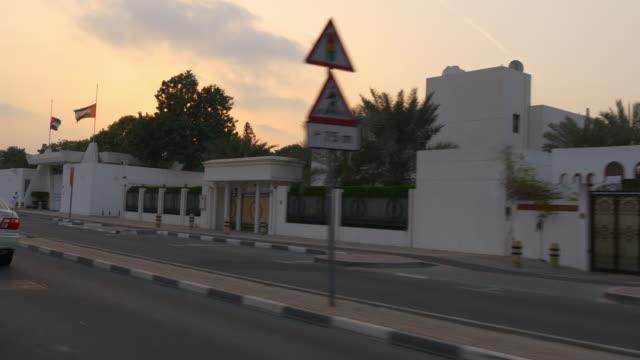 sunset sky dubai city road trip side window jumeirah street  4k united arab emirates video
