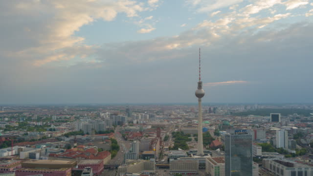 sunset sky flight over berlin cityscape tv tower district aerial panorama 4k timelapse germany
